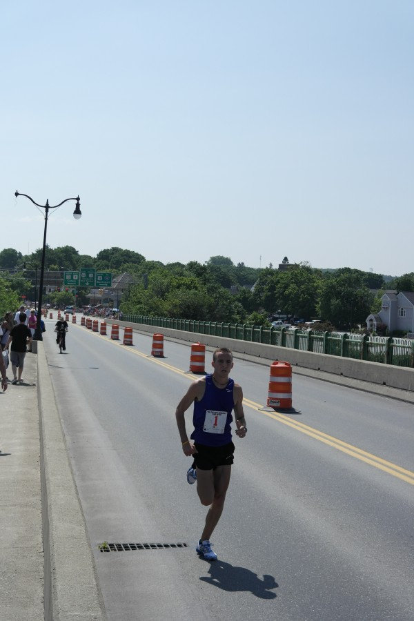 Riley Masters of Veazie crosses the Joshua Chamberlain bridge Thursday morning on his way to victory in the Walter Hunt Memorial 3K road race from Brewer to Bangor. Masters won the shortened race in 6 minutes, 35 seconds.