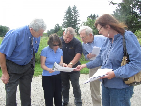 County officials and representatives look at a map concerning where the county will be cutting trees as part of an airport safety project. The county needs to obtain easements on 15 properties in South Thomaston to move ahead with the cutting.