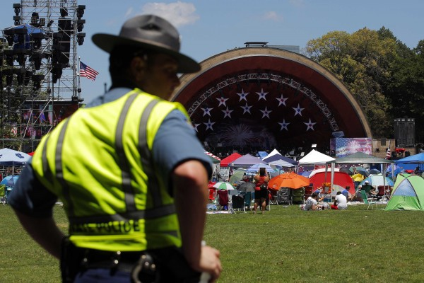 A Massachusetts State Police trooper watches over the oval in front of the Hatch Shell ahead of the city's Fourth of July Independence Day celebrations in Boston, Mass., on Thursday, July 4, 2013.