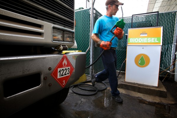 Jim Kilmartin of Maine Standard Biofuels in Portland puts biodiesel in his delivery truck's fuel tank before taking a load north to the rock band Phish in Bangor, Maine Standard Biofuels makes biodiesel with used cooking oil from nearly 800 restaurants from Bar Harbor to Boston.
