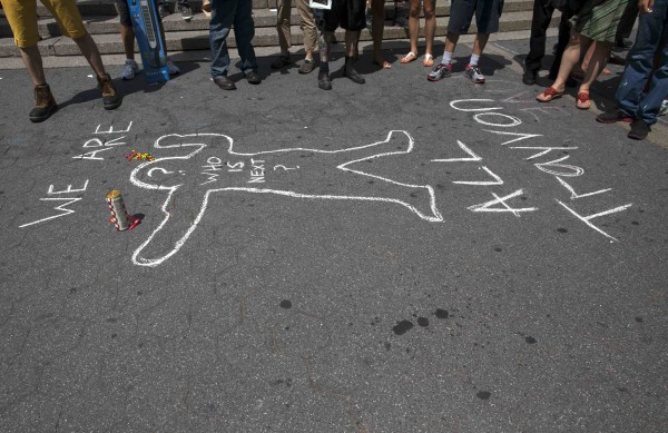 A mock chalk outline along with candy and a soft drink similar to that bought by Trayvon Martin before his death is pictured during a rally in reaction to a not guilty verdict for George Zimmerman in New York on Sunday.