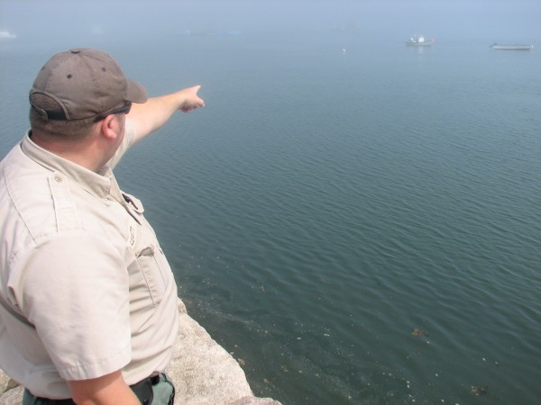 Marine Patrol Officer Jason Leavitt points to to buoy near where a van carrying to women and a dog sank Tuesday night off a boat ramp in Roque Bluffs. The women and dog drowned in the accident.