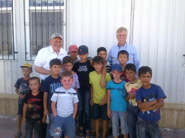 Sen. Angus King, I-Maine, and Sen. Carl Levin, D-Mich., chairman of the Senate Armed Services Committee, pose for a photo with Syrian refugee children at Nizip 2 camp.
