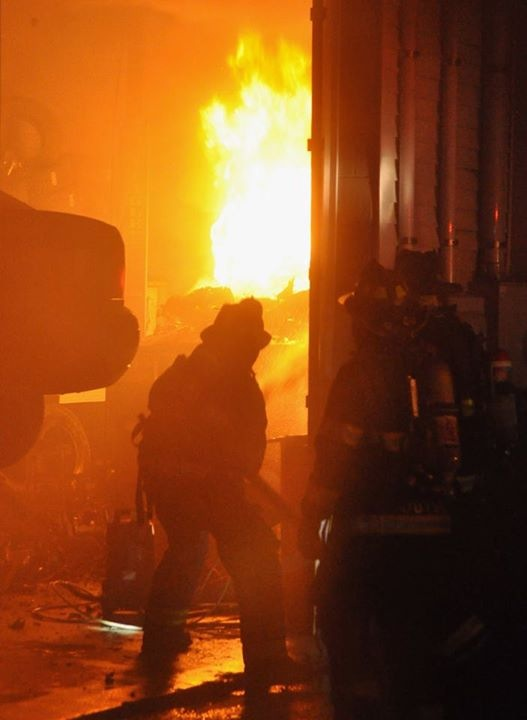 Crews battle a fire at a used car dealership in Portland late Wednesday night.