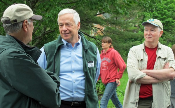 U.S. Rep. Mike Michaud (center) speaks with members of the Penobscot Fly Fishers club during Orland River Days on Saturday.
