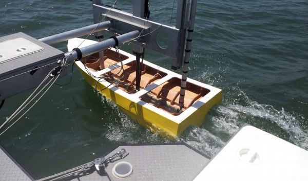 Penobscot East Resource Center's one-fifth scale trimaran lobster boat is tested in the water at a San Diego facility in May.