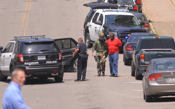 Bangor police arrest the man that fired about 70 rounds in a downtown Bangor apartment.
