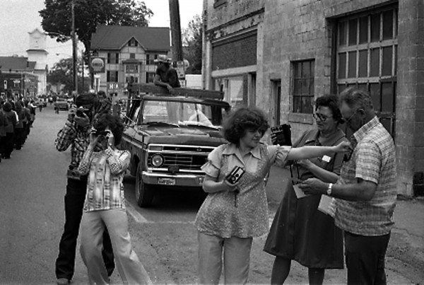 Belfast photojournalist Richard Norton took this photo of parade-goers snapping photos sometime in the 1970s or 1980s.