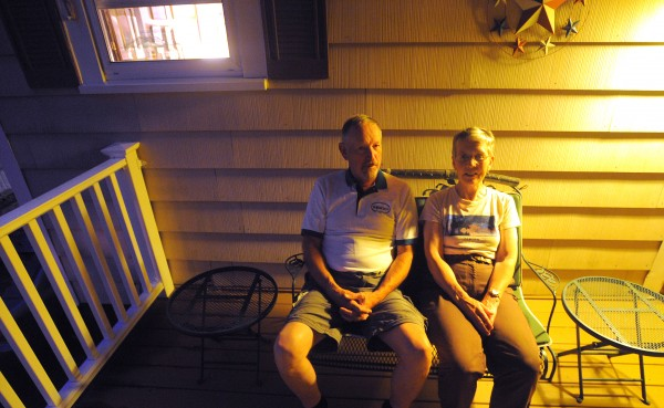 Mike and Della Gleason on the porch of their Bangor home. They are not opposed to the concerts on the waterfront, but are opposed to the high noise level of the concerts.