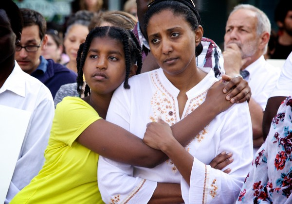 Abeir Dhalac and her daughter Walla Mohamed listen to speakers in Portland's Monument Square Monday afternoon during a memorial service and rally for Trayvon Martin.