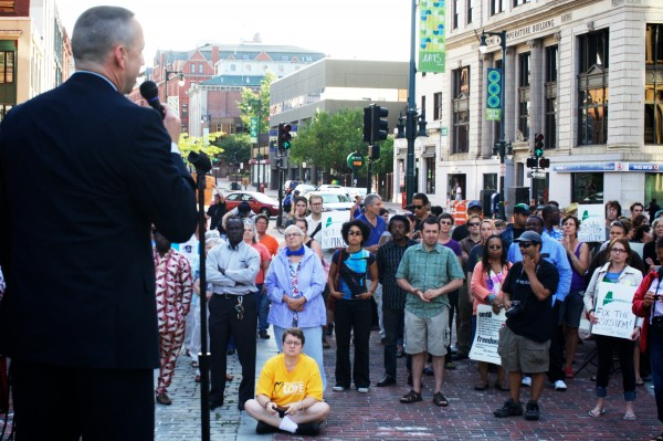 Portland Police Chief Michael Sauschuck speaks to the crowd in Portland's Monument Square Monday afternoon during a memorial service and rally for Trayvon Martin.