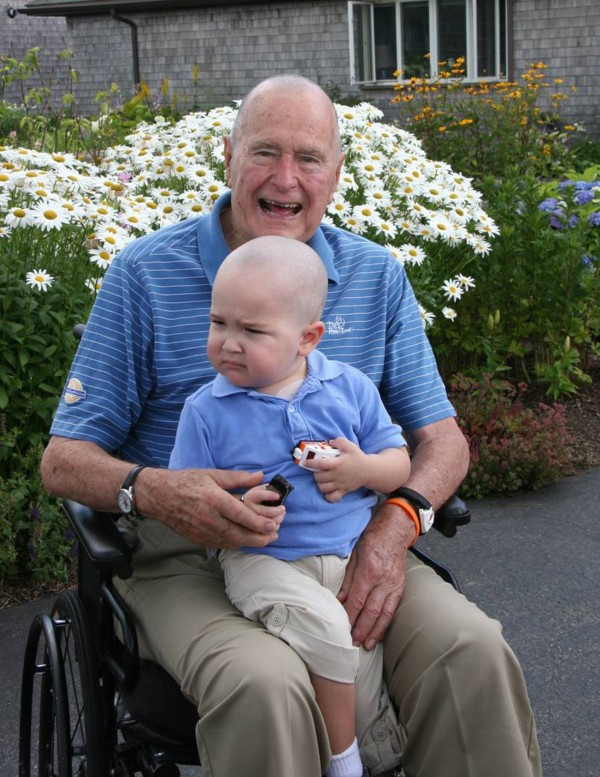 Former President George H.W. Bush poses at Walker's Point, Maine, after joining members of his Secret Service detail in shaving his head to show support for Patrick, the two year-old son of a detail member who is being treated for leukemia and started losing his hair.