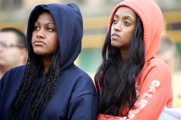 Tarikuwa Lemma (left) and Liya Fouse wear hoodies in solidarity while listening to speakers in Portland's Monument Square Monday afternoon during a memorial service and rally for Trayvon Martin.