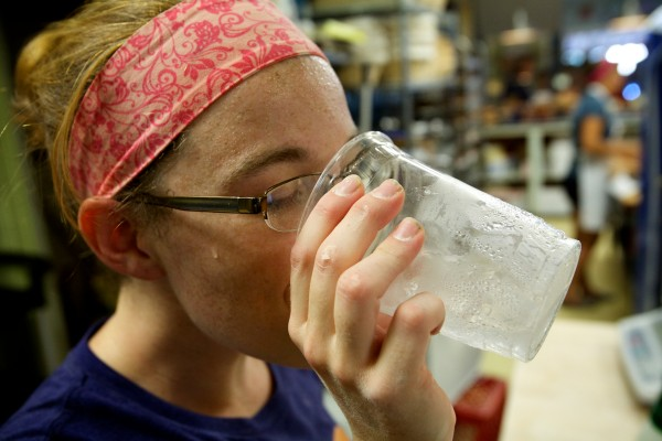 Melanie Roy takes a drink of water while making bread at Scratch Baking Co. ion South Portland on Wednesday.
