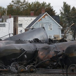 Melted siding on a house is pictured close to the train wreckage in Lac-Megantic July 9, 2013.
