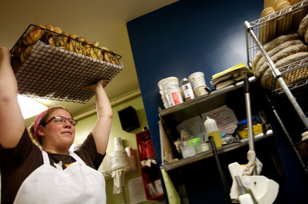 Emily Pappas takes a load of bagels to the counter at Scratch Baking Co. in South Portland Wednesday.