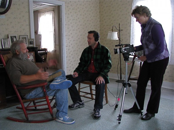 Jerry Nelson, a Swedish speaker in the DVD &quotOld Maine Swedish Farms&quot produced by Crown of Maine Productions of Madawaska Lake, is pictured being interviewed at the Ostlund House by Scandinavian scholar, Dan Olson, and filmed by Brenda Jepson. The half hour documentary about the last of the Swedish speakers in Maine's Swedish Colony, released in 2010, features six residents of the Maine Swedish Colony recounting their stories of growing up on area farms.