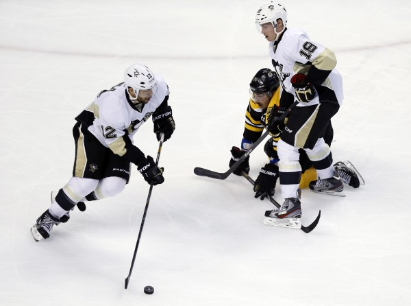 Pittsburgh Penguins right wing Jarome Iginla (12) takes the puck away from Boston Bruins center Brad Marchand (63) with the help of right wing Beau Bennett (19) during an NHL playoff game on June 5. The Bruins have signed Iginla to a one-year contract.