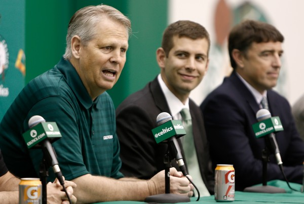 Boston Celtics General Manager Danny Ainge talks about hiring new head coach Brad Stevens, center, as owner Wyc Grousbeck, right, listens in during a news conference announcing Stevens new position.