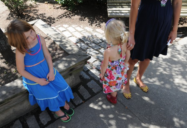 Kate (from left) and Elizabeth, children of Megan Rice of Belgrade, listen as their mother talks to the media about how she attempted to raise her girls in a BPA-free environment and the challenges of doing so.