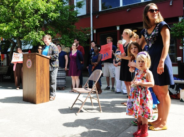 Supporters of the Alliance for a Clean and Healthy Maine gather at West Market Square in Bangor on Wednesday to protest Gov. Paul LePage's veto of LD 1181, also known as the Healthy Kids Bill.