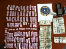 Investigators from the Maine Drug Enforcement Agency, the Maine State Police and the Belfast Police Department seized 100 bags of heroin as well as prescription painkillers, digital scales and $1,000 cash during a drug raid Wednesday night.