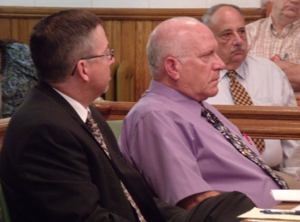 James Dunleavy, left, a Presque Isle attorney, watches as his client, Roy Woods, 68, of Caribou, listens during his sentencing hearing in Aroostook County Superior Court in Caribou on Thursday, July 25, 2013.