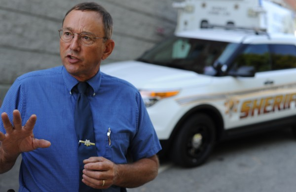 Penobscot County Sheriff Glenn Ross stands in front of two of the department's Ford SUVs in August 2012. Ross said that flat funding from the state may force layoffs at the Penobscot County Jail.