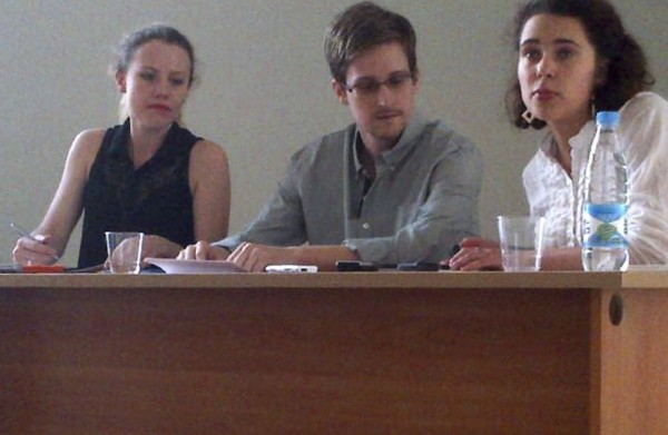 Former intelligence agency contractor Edward Snowden and Sarah Harrison, left, of WikiLeaks speak to human rights representatives in Moscow's Sheremetyevo airport July 12, 2013.