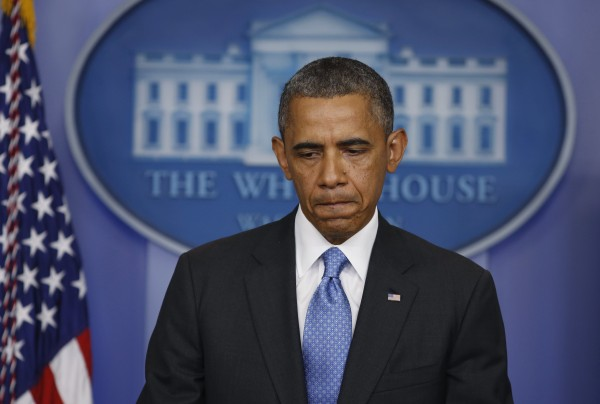 U.S. President Barack Obama pauses as he talks about the Trayvon Martin shooting in the press briefing room at the White House in Washington, July 19, 2013.