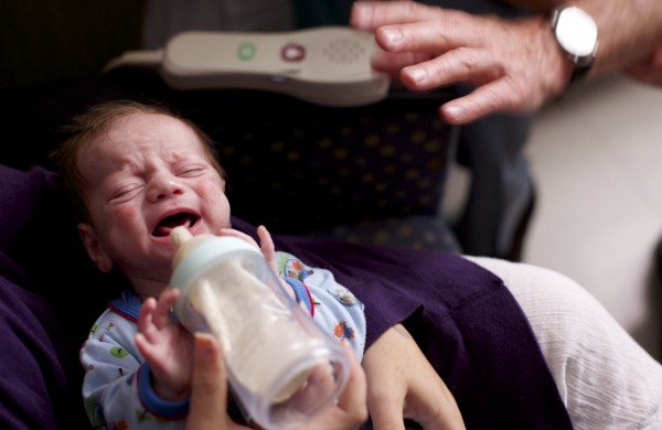 A one-month-old baby cries at Eastern Maine Medical Center, where Dr. Mark Brown spoke with the baby's mother while showing the pediatric patient room at EMMC Wednesday afternoon in Bangor. Brown works with drug-affected newborns and is involved in research about opiate-exposed babies.