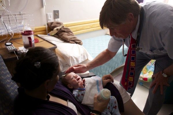 Eastern Maine Medical Center's Dr. Mark Brown talks to a one-month-old baby's mother while showing the pediatric patient room at EMMC Wednesday afternoon in Bangor.