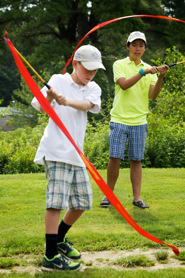 Young golfers Dana Hinchcliffe, 13, (left) and Kevin Ly, 13, use ribbons and sticks to hone their drive skills at the grand opening of the South Course Clubhouse at the Riverside Golf Course in Portland Friday.