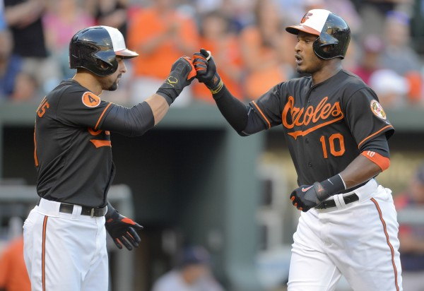 Baltimore Orioles batter Adam Jones is greeted by teammate Nick Markakis (L) after connecting for a first inning, two-run homer off of Boston Red Sox starting pitcher John Lackey during the first inning of their American League baseball game in Baltimore on Friday night. The Orioles won 6-0.