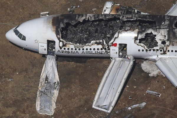 An Asiana Airlines Boeing 777 plane is seen after it crashed while landing at San Francisco International Airport in California, in this file aerial view taken July 6, 2013. A Chinese girl died in the hospital Friday, making her the third fatality as a result of the crash.