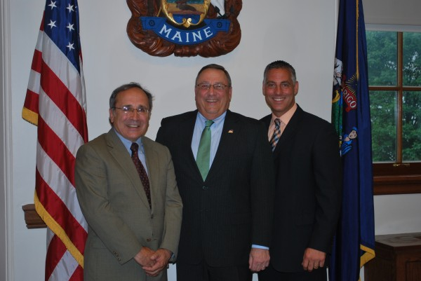 Gov. Paul LePage (center) swore in former Calais lawyer David J. Mitchell (right) to serve as a District Court judge for Washington County and Judge John V. Romei (left) to serve as an active retired District Court judge.