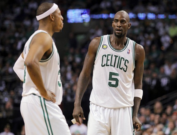 Former Boston Celtics players Kevin Garnett, right, and Paul Pierce in this April 2013 file photo. The Boston Celtics and Brooklyn Nets officially announced the blockbuster trade Friday that sent Garnett and Pierce and guard Jason Terry to the Nets.