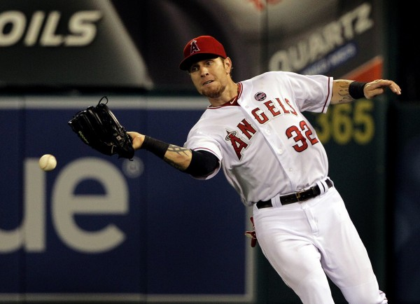 Los Angeles Angels right fielder Josh Hamilton misplays a fly ball hit by Jonny Gomes of the Boston Red Sox, allowing Boston's Shane Victorino to score the go-ahead run in the seventh inning at Angels Stadium on Friday night, July 5, 2013, in Anaheim, Calif.