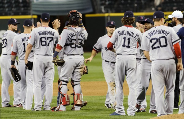 The Boston Red Sox celebrate after defeating the Seattle Mariners at Safeco Field in Seattle 11-4 Wednesday night. The Red Sox went on to beat the Mariners on Thursday 8-7 in 10 innings.