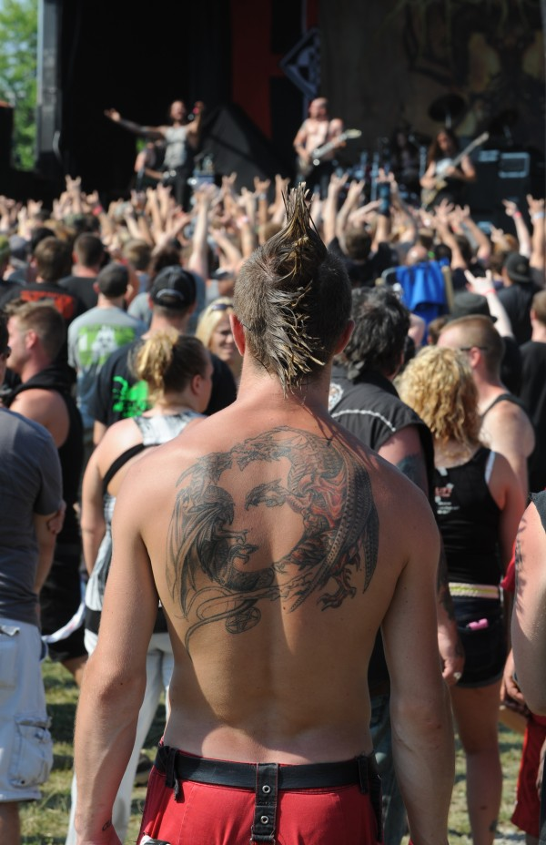 Heavy metal fan Michael Jameson of Bangor sports a mohawk and no shirt as he watches the heavy metal band, Job For A Cowboy, during the RockStar Energy Drink Mayhem Festival in Bangor on Wednesday.