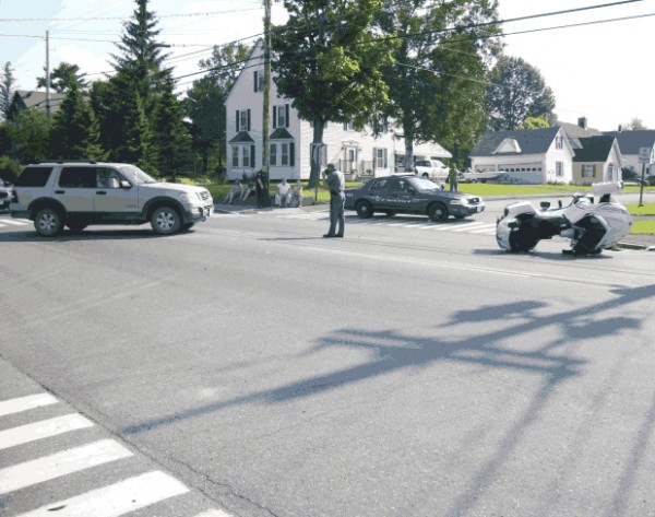 Police investigate the cause of an accident at South Main and Vaughn streets in Caribou on Sunday.