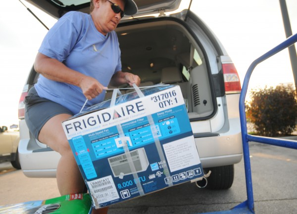 &quotIt does test your patience at times,&quot said Laura Michaud of Dedham, referring to the heat, as she loaded a new air conditioner into her vehicle at Lowe's in Brewer on Tuesday