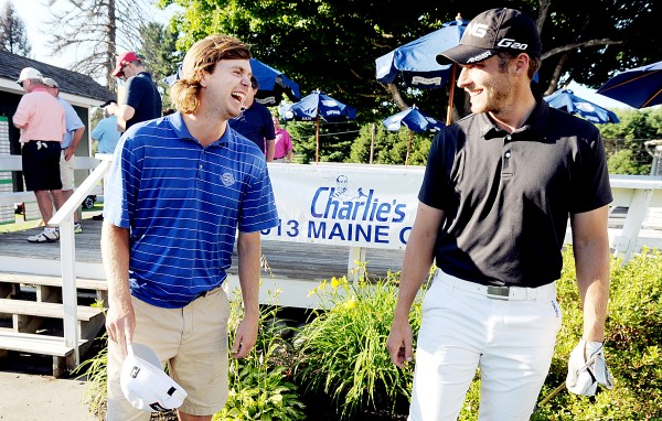 Evan Harmeling (left) of Andover, Mass., shares a laugh with Bangor native Jesse Speirs after Harmeling won the 95th Charlie's Maine Open by one shot over Speirs at Augusta Country Club on Tuesda