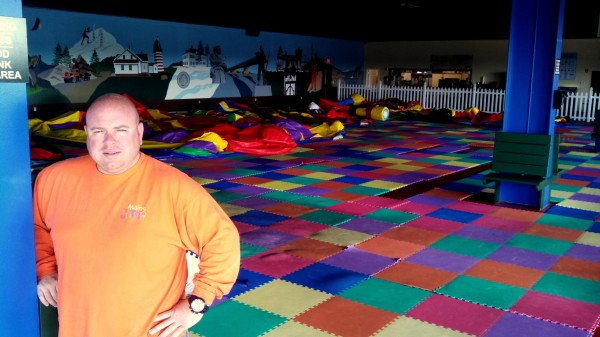 Ryan Hatch, the owner of The Maine Jump in Bangor, stands in his facility before it opens on Wednesday morning, July 17, 2013. The Maine Jump will have a grand reopening on July 23 after a series of renovations, including upgraded security, new inflatable amusements.