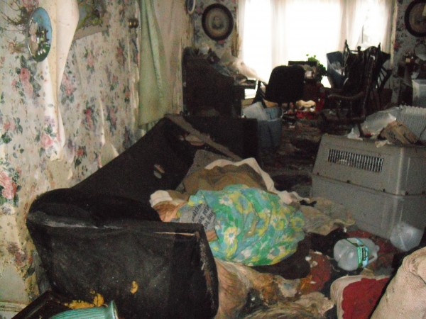 The living room of 8 East Summer St., a home that was deemed a health hazard by a judge in June and was demolished by the City of Brewer on Monday, July 29, 2013.