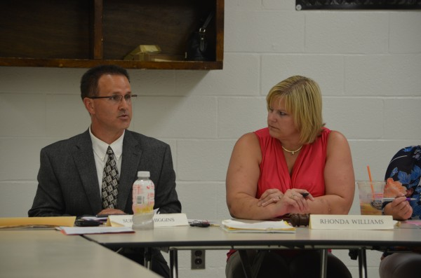 RSU 64 Superintendent Daniel Higgins speaks to the board of directors during a meeting at Central High School in Corinth on Wednesday as Rhonda Williams looks on.