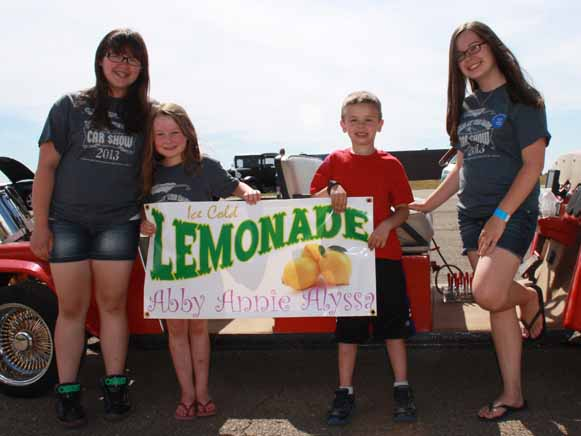 One of the sponsors for the Blood Brothers and Sisters Car Show held at Loring over the weekend in conjunction with the land speed races was a very sisterly trio that raised funds for the Hemophilia Alliance of Maine by selling lemonade. The idea was spawned by Abbie St. Peter, and she was assisted by her big sisters Annie, at right, and Alyssa Sinclair. They're pictured here with Abbie''s friend Evan LaPierre, whose parents organized the event.