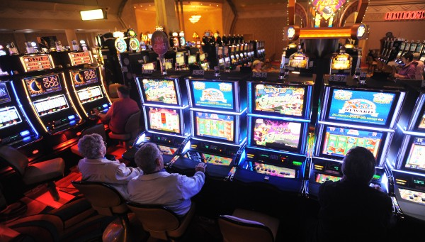 People play slot machines at the Hollywood Casino in Bangor.