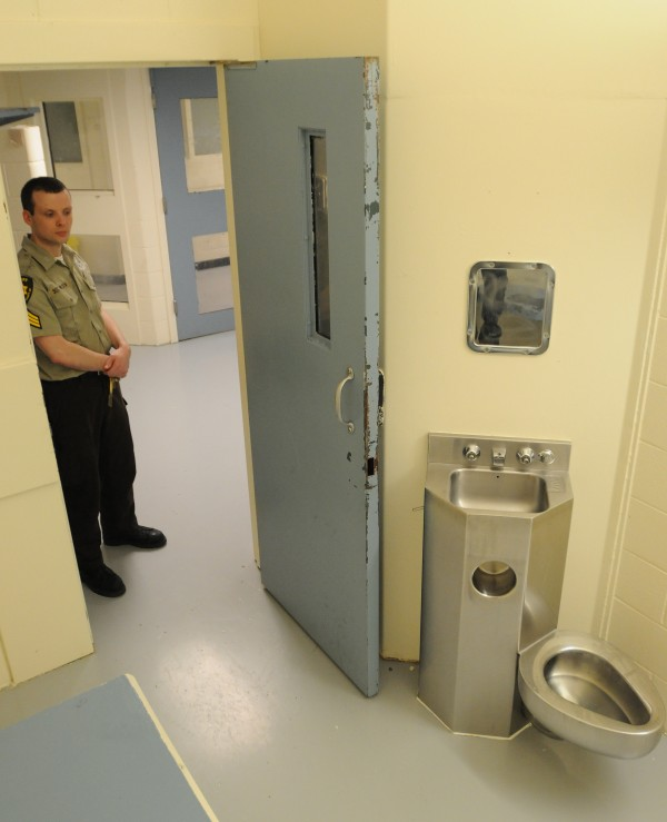 Penobscot County Corrections officer Sgt. Chris Wilson stands near the door of a empty cell at the Penobscot County Jail on Thursday. Penobscot County Commissioners took a tour of the facility to get a better understanding of staffing and overcrowding issues at the jail.