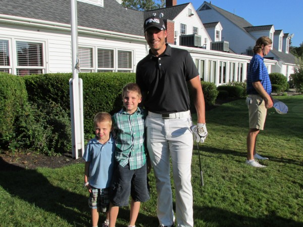 Professional golfer Jesse Speirs (right), a Bangor native, poses with his nephews (from left) Ryan Speirs, 4, and Justin Speirs, 8, after Tuesday's second round of the Charlie's Maine Open Championship at Augusta Country Club in Manchester. Justin Speirs rode around the course in the cart Tuesday with his uncle Jesse
